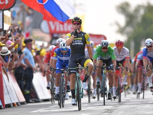 Tour de France stage seven: Dylan Groenewegen wins