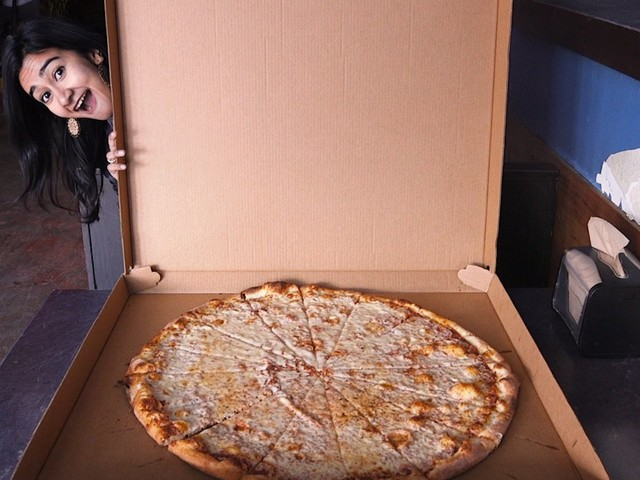 A pizza shop in Dallas is known for its massive slices, and it's a must visit