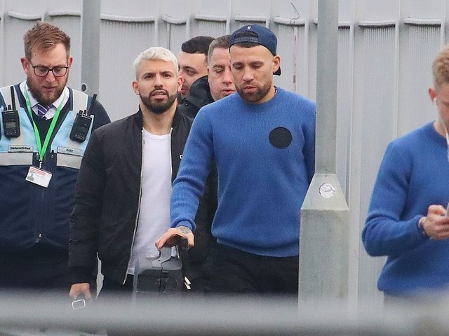 Pep Guardiola and Manchester City players catch train to London ahead of Carabao Cup final - pictures