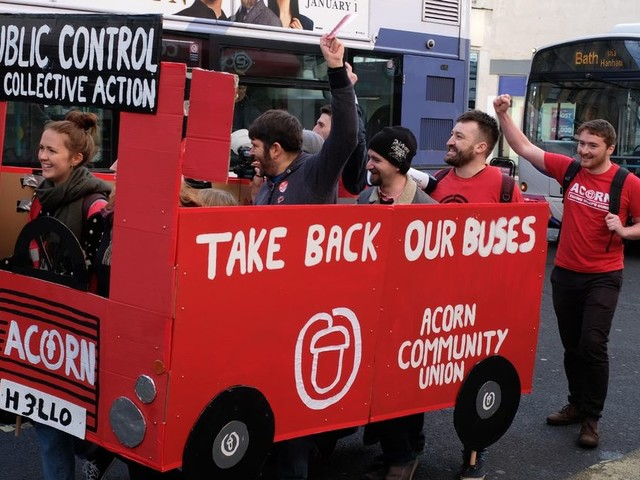 Protesters march along Bristol road in cardboard bus chanting 'First Bus go away'