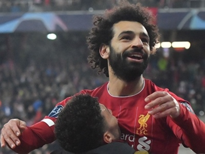 Salah's wonder goal makes it 200 as Liverpool advance in Champions League