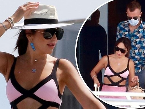 Nigora Bannatyne, 40, flaunts her incredible figure in a pink cut-out swimsuit in Spain