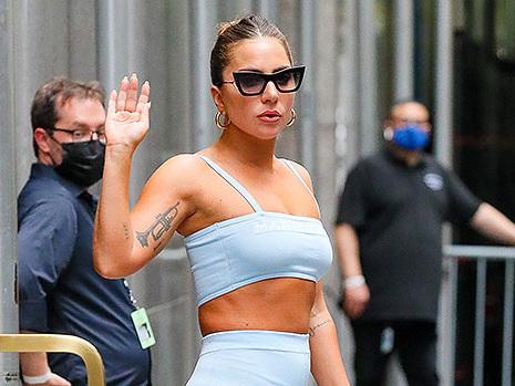 Lady Gaga Rocks A Powder Blue Crop Top & Leggings Outside Radio City Music Hall In NYC