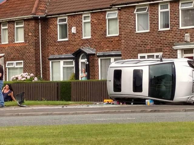 Car flips over after crash on Liverpool road