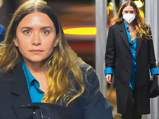 Ashley Olsen looks typically chic in a black coat and blue shirt as she walks home after dinner