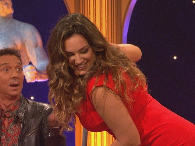 Kelly Brook flaunts eye-popping cleavage in dangerously plunging dress after admitting she wants boyfriend to propose