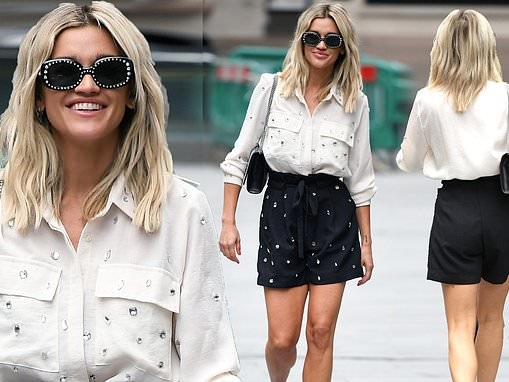 Ashley Roberts wears embellished blouse with paper-bag shorts