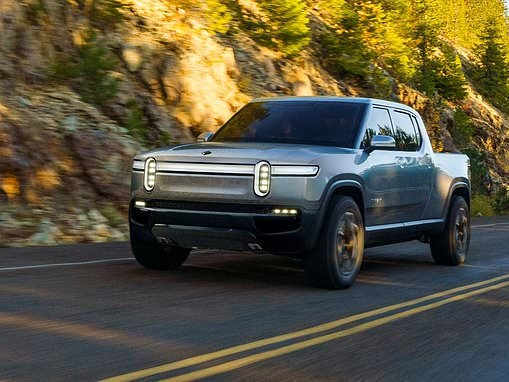 Amazon places big bet in Tesla rival and electric truck startup Rivian