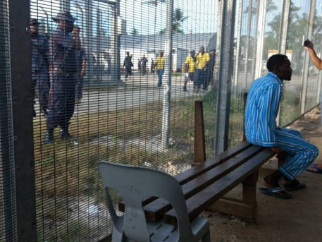 Baton-wielding police clear closed Australia refugee camp in PNG