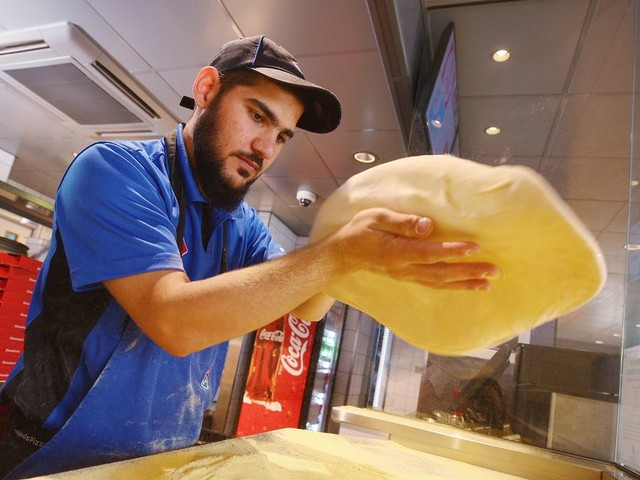 Domino's worker makes perfect pizza in just 27 seconds - and is fastest in Europe