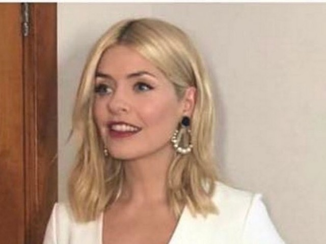 Holly Willoughby wows in flirty white dress and statement earrings for Brit Awards 2018