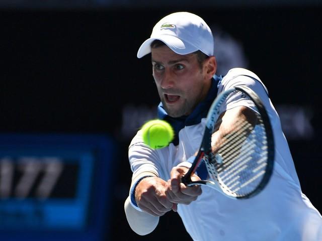 He's back: Novak Djokovic makes emphatic return to thrash Donald Young at the Australian Open