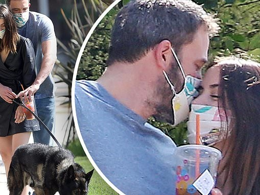 Ben Affleck wraps his arms around his girlfriend Ana de Armas as they take their dogs for a walk