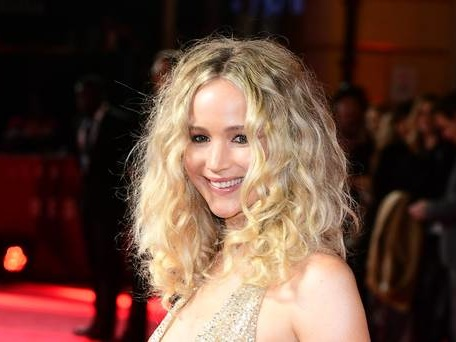 Jennifer Lawrence glitters in gold at Red Sparrow premiere