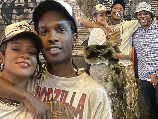 Rihanna looks completely smitten as her boyfriendA$AP Rocky wraps his arm around her in Miami