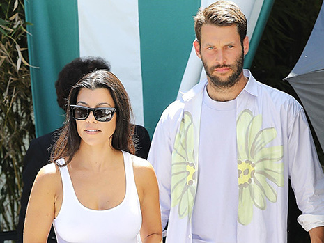 Kourtney Kardashian Wears Nothing Underneath A White Tank Top With A Scott Disick Look-Alike