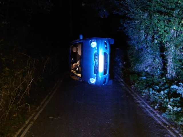 Lovers rescued by police after car they were 'strengthening relationship' in flips over