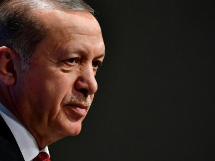 Turkey puts on trial 17 staff from anti-Erdogan daily