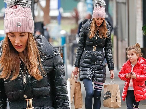 Skinny Bec Judd dotes on her lookalike daughter Billie on a shopping trip