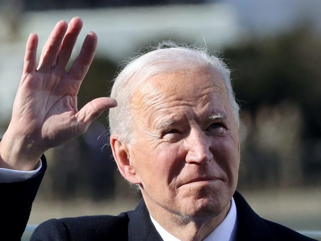 Biden extends a hand to the world on first day as president by rejoining Paris climate accord and WHO, while revoking Trump's travel ban