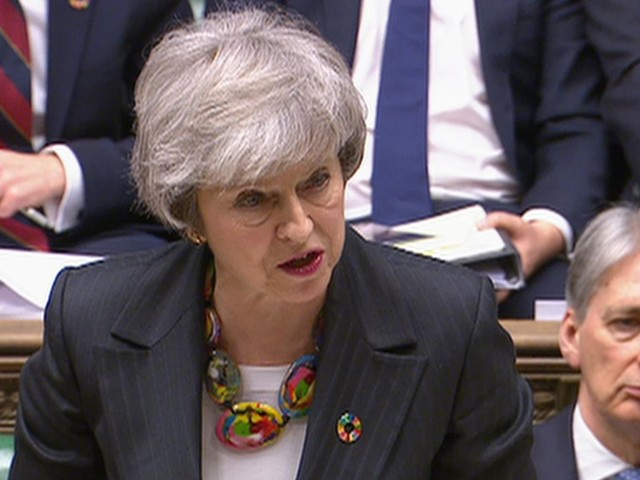 May heckled as she denies 'running down the clock' on Brexit