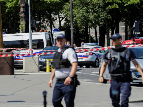 Car explodes after hitting police van on Paris's Champs-Elysees