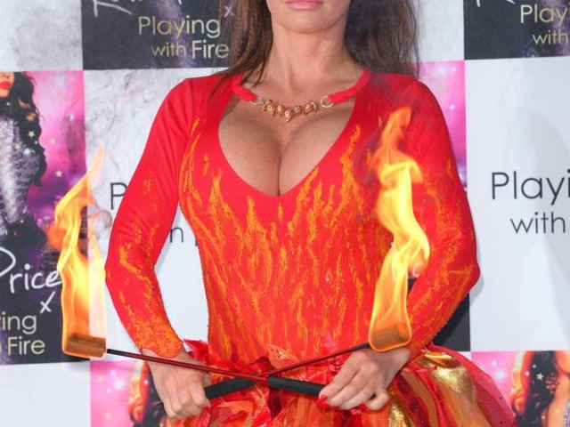 AMAZING PICS! See Katie Price's most outrageous outfits EVER as she blows FIRE at launch event!