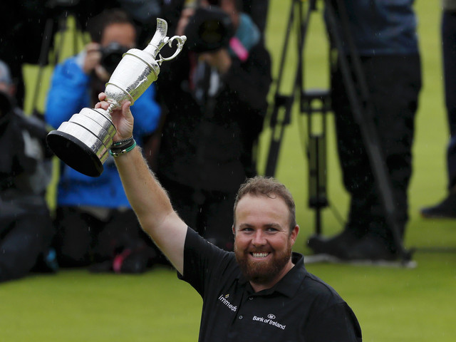Lowry holds nerve to clinch first major title at The Open