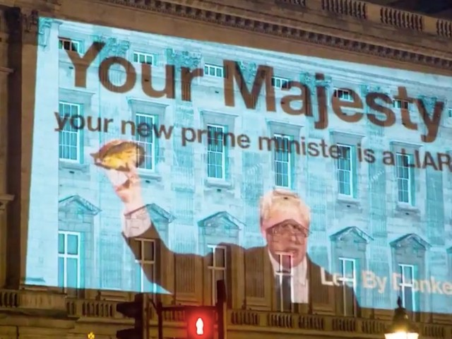 'Your new prime minister is a liar': Protest message to the Queen projected onto Buckingham Palace