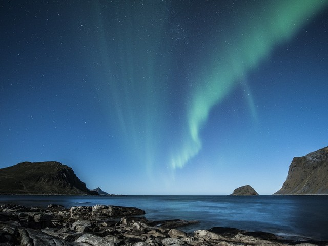 Auroras unlock the physics of energetic processes in space