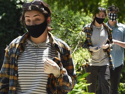 Charli XCX wears a face mask and gloves while enjoying an outing with beau Huck Kwong
