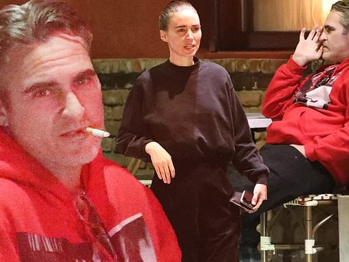 Joaquin Phoenix enjoys a smoke break following dinner with Rooney and Kate Mara