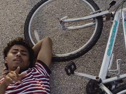 17 year old Houston hip hop newcomer Aaron May boasts hopeful rap on the gliding 'Ride'