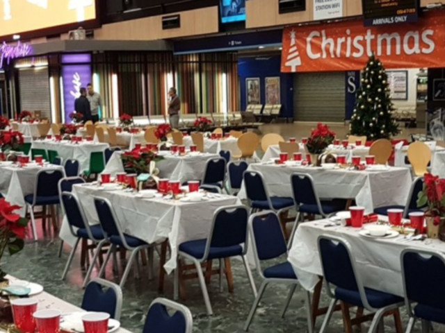 London's Euston Station Hosts Christmas Dinner For The Homeless