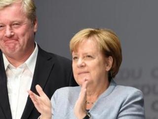 Merkel predicts tight race in German regional vote