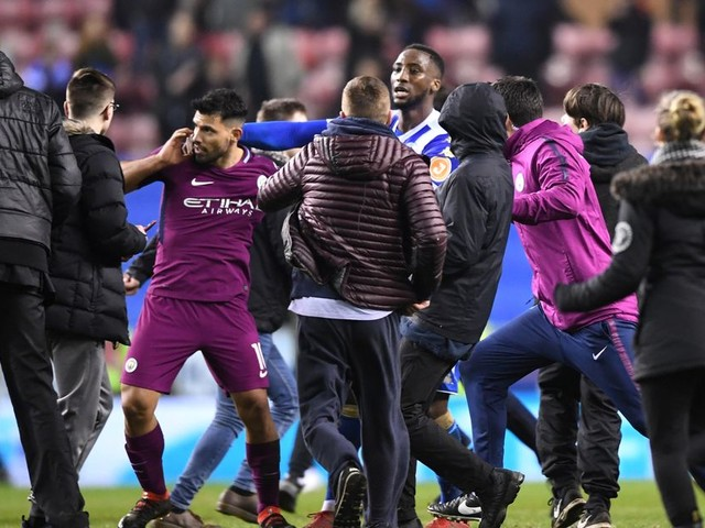 Manchester City ace Sergio Aguero involved in on-pitch altercation with Wigan fan after FA Cup exit