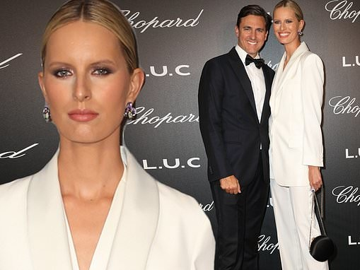 Karolina Kurkova cuts a chic figure in white tailored suit at Cannes Film Festival's Chopard party