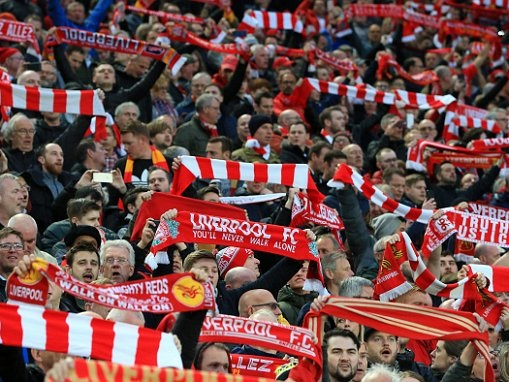 Liverpool fans deliver a sea of noise and colour to carry side to victory