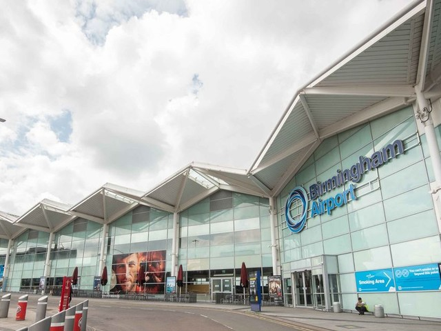 Man, 23, arrested at Birmingham Airport charged in connection with shooting which left two injured