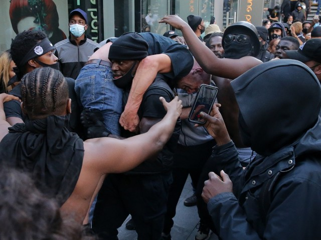 Reaction: BLM activist saves counter-protester amid violent clashes
