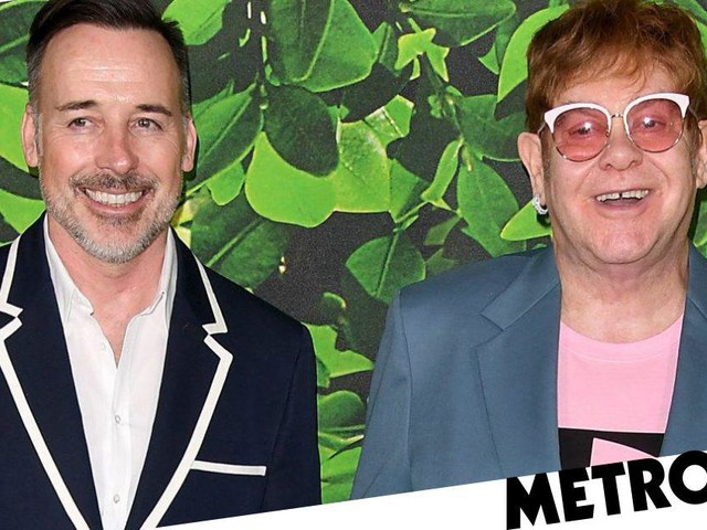 Elton John looks happy as Larry as he poses with husband David Furnish