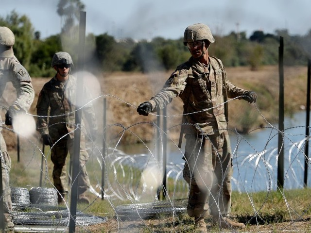 Hundreds of additional US troops take position in California as migrants clash with border patrol