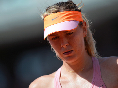 Sharapova pulls out of Toronto with left arm injury