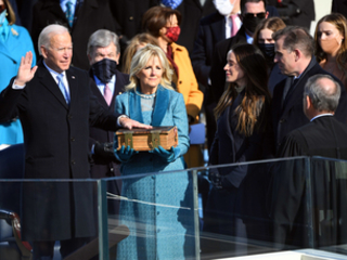 'A cry for survival comes from the planet itself': Joe Biden issues climate action rallying call as he is sworn in as 46th US President