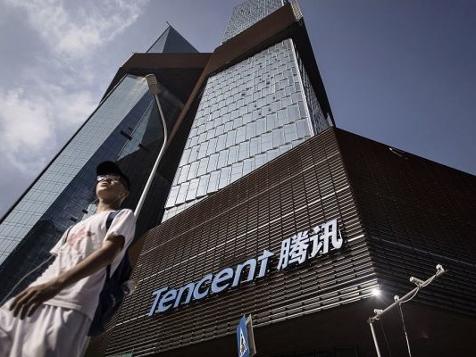 Chinese internet giant Tencent suffers a rare profit drop