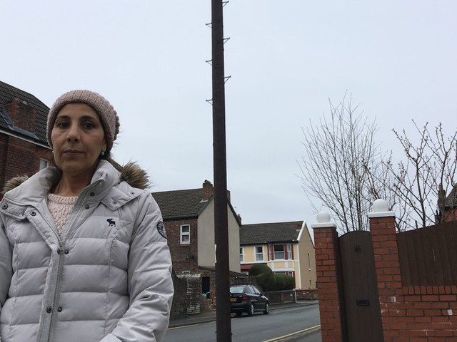 Woman says she'll leave the country because she feels threatened by telephone pole