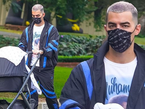 Joe Jonas is a doting dad as the pop star takes a solo walk with two-month-old daughter Willa