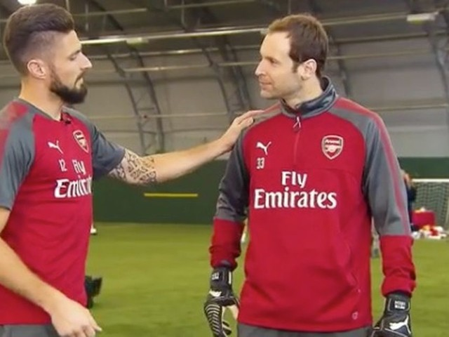 Arsenal stars donate a day's wages to charity as Gunners' keeper Petr Cech shows off his skills catching pennies