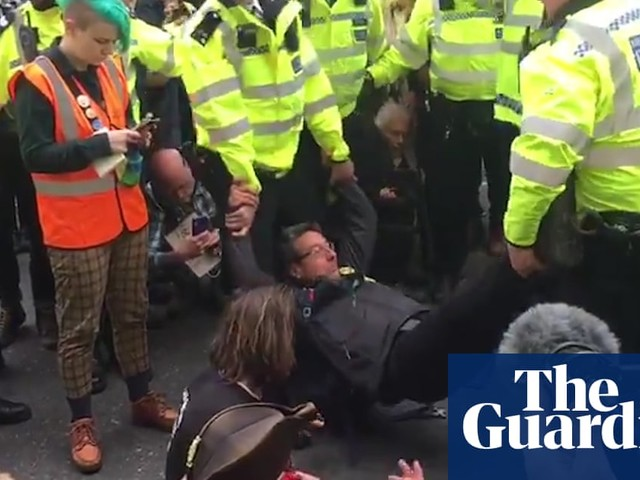 George Monbiot arrested for defying climate protest ban – video