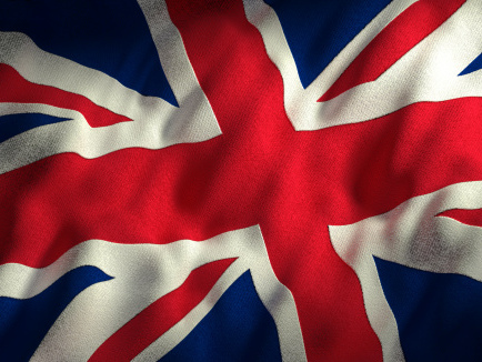 British Pound Halts Slide as UK Surprises With Budget Surplus